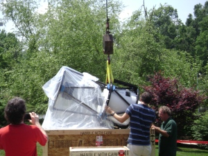 Hoisting the new 24-inch telescope out of the shipping crate.